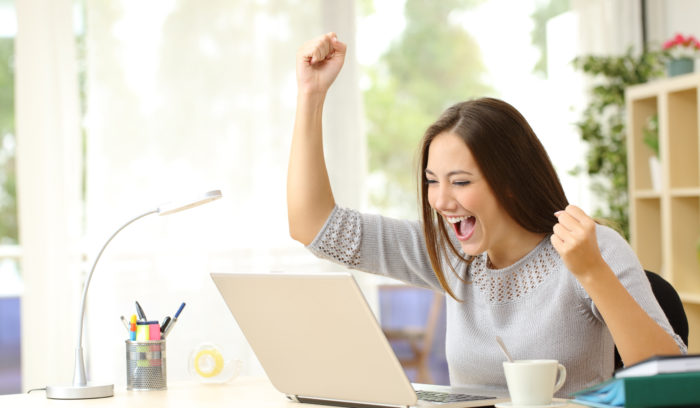 woman at computer excited about free shipping
